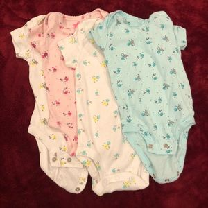 Other - NWOT 4-pack floral onesies. Different colors
